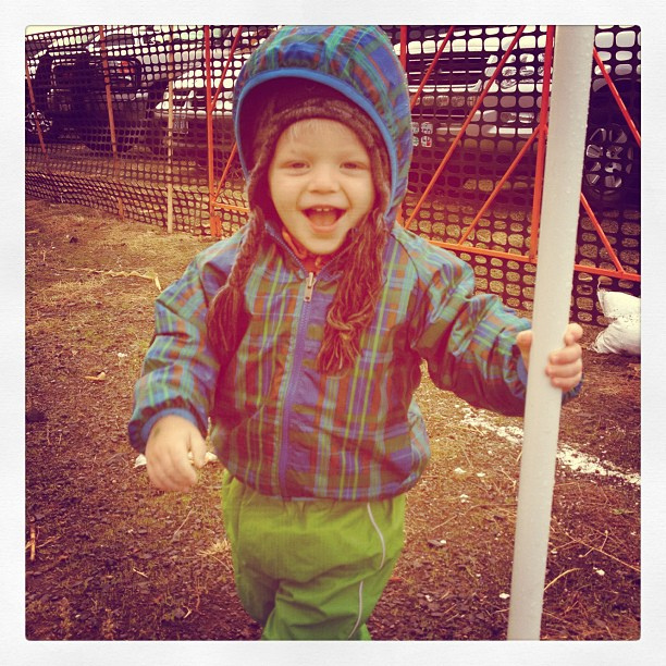There are so many things I love about this photo. He was playing hide and seek behind tiny pole. Rain paint outfit cracks me up too. #mamajoy