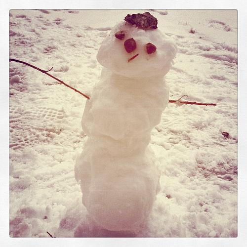 True's first snowman. Adorable.