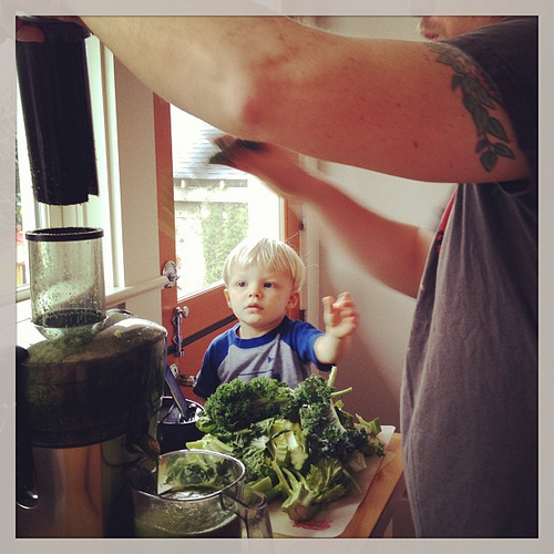 """True loves juicing with us. He hands papa all the pieces of greens one by one. Takes forever but he feels like HE made the juice """"all by himself"""" today we made an entire pitcher of green juice.  @lacylike"""
