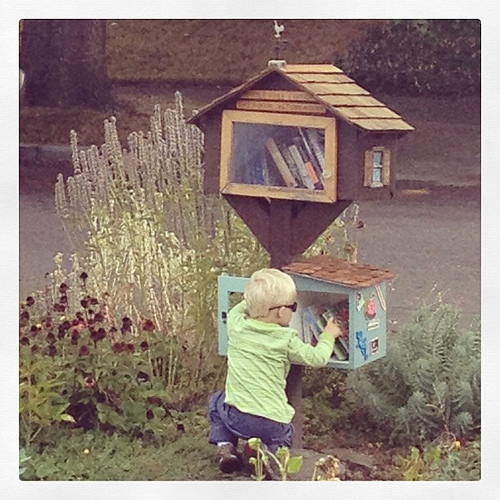 He's really into the kid's annex on our #littlefreelibrary. #warmsmyheart #lovethiskid #trueelioorlando