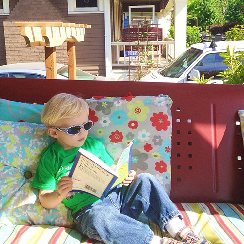 Found him just like this yesterday afternoon after grabbing a new book from out #freelittlelibrary in the front yard. This kid is so my son. Being his mama has been a privilege of a lifetime.  #alonetime #sunseeker